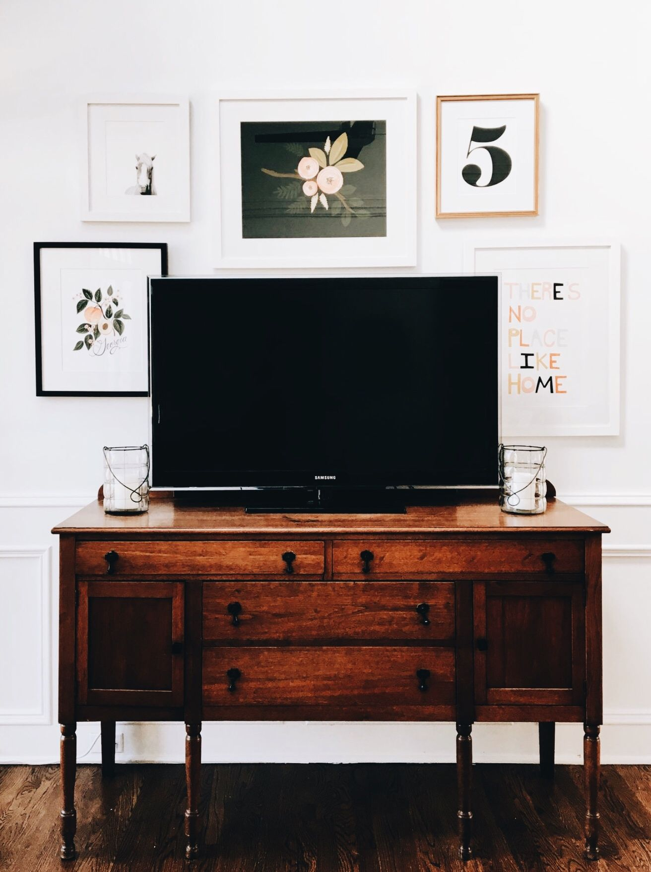 An Old Buffet Is Now Used As Storage And A Tv Stand Mixing With The New