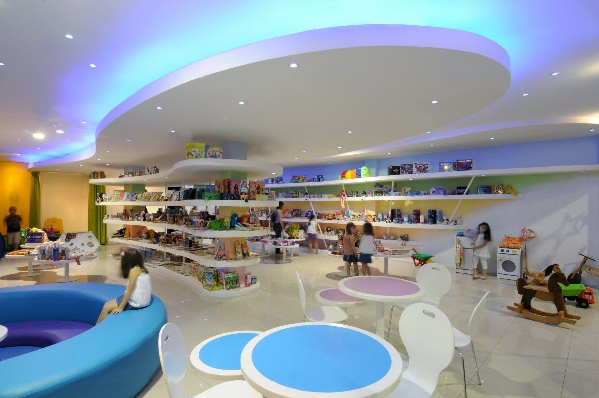 Contemporary reading corner design - Kids Toy Store Interior Design By Juan Carlos Menacho