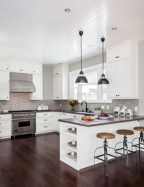 Contemporary Kitchen Features A Beadboard Ceiling Over White Shaker Cabinets Adorned With Oil Rubbed Bronze Hardware And Gray Quartz Countertops