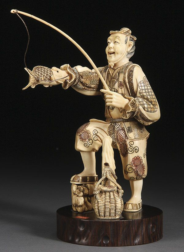 A Japanese carved ivory Okimono of a Fisherman