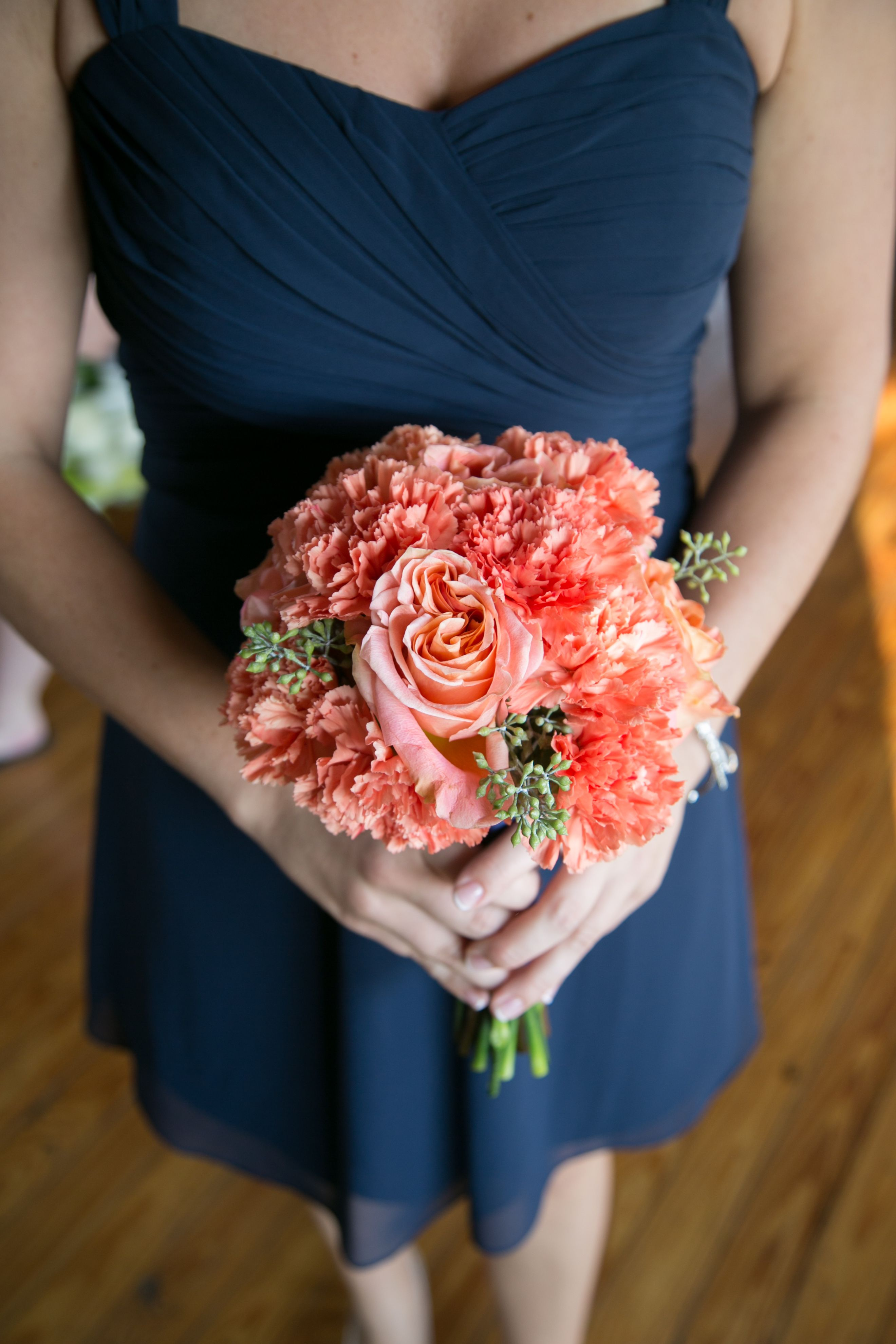 Coral Carnation Bridesmaid Bouquet With Navy Dress Carnation