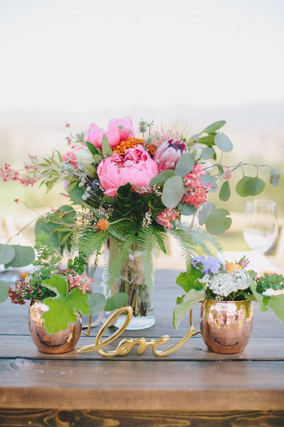 Love The Use Of Copper Moscow Mule Mugs As Mini Vases For Table
