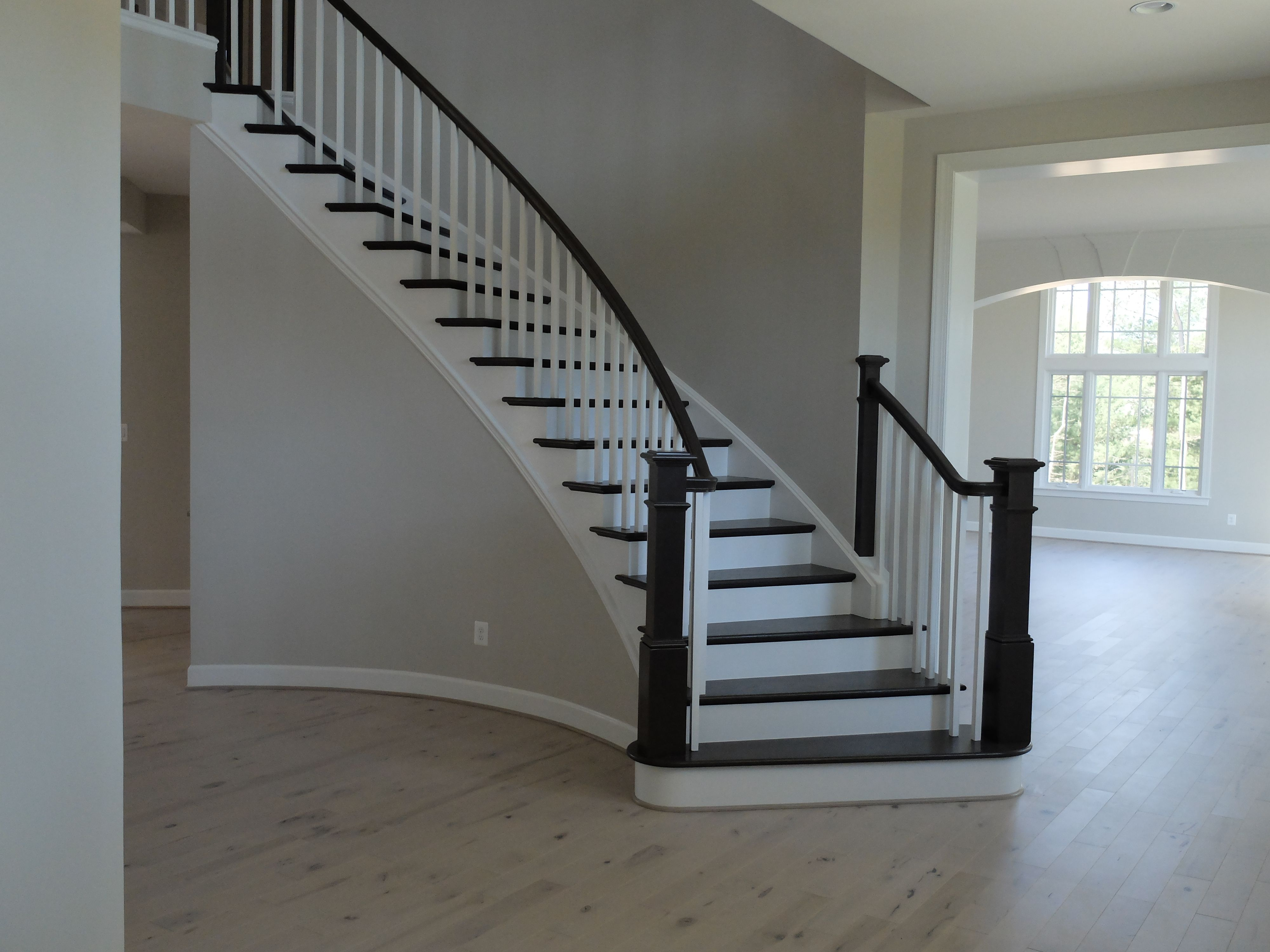 Best Graceful Curving Staircase Dark Wood White Trim Light 400 x 300