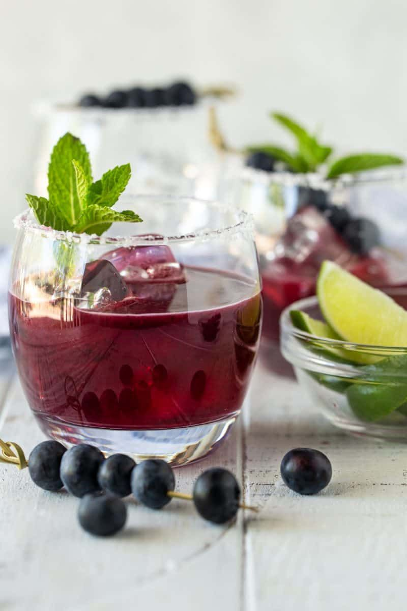 Don T Let The Gorgeous Color Fool You Into Thinking This Is A Super Sweet Drink Easy To Make As A Batch Cocktail The In 2020 Moscato Sangria Blueberry Margarita Food