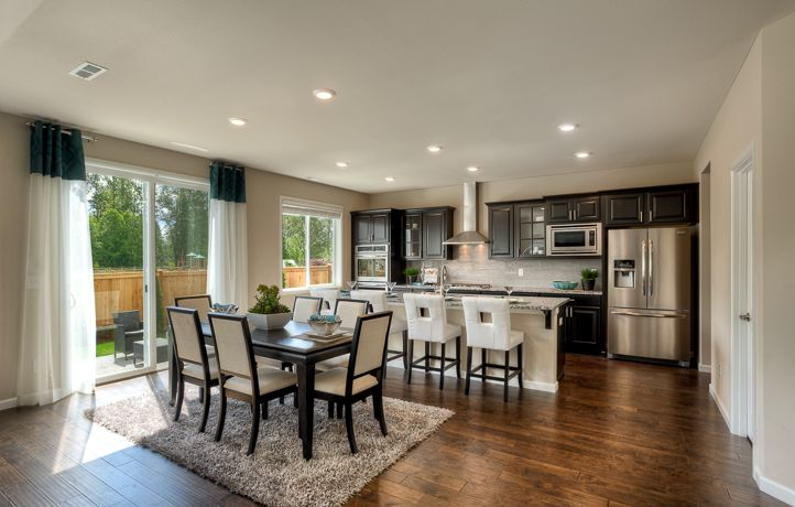 The Carnation is the perfect home for entertaining! It has three areas for dining! Perfect for dinner parties.