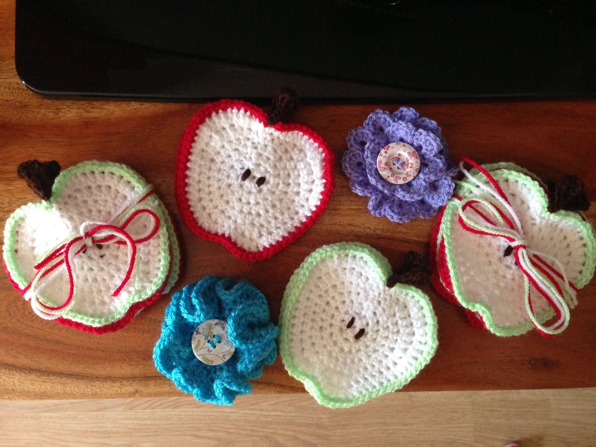 Crochet apple coasters and flower broaches for end of year