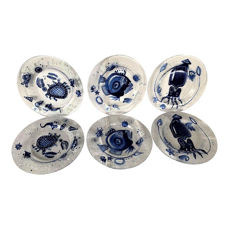 6 vintage Gliltzer Porzellan Ocean Blue salad plates made in Germany. Two plates depicting fish, crabs, and octopus. These are pre-owned items so please see all the pictures and ask any questions.