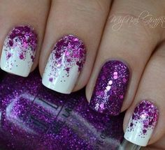 Half moon purple glitter nail art design on top of a matte white nail polish.