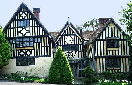 the timber beams on tudor houses are uneven because they were cut
