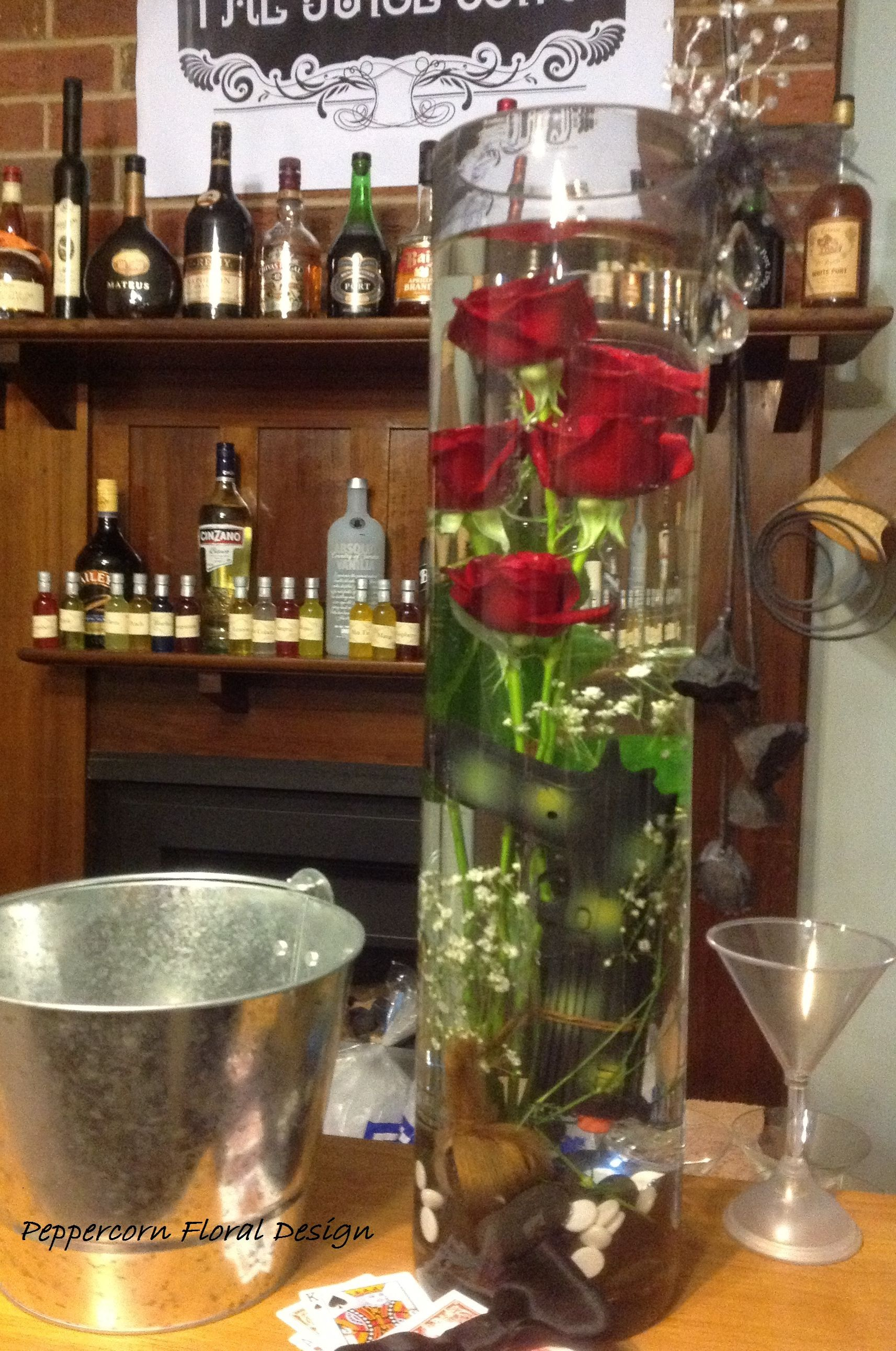 Red rose and babyus breath tall vase flower arrangement for bar or