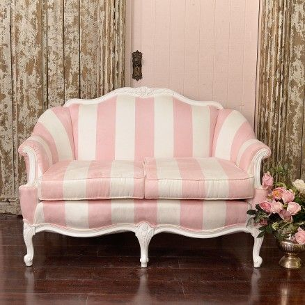 This settee features a charming French style frame with amazing ...
