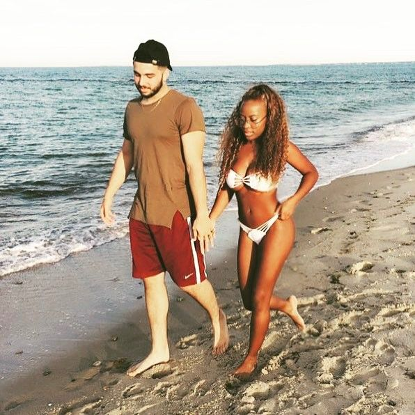 Beautiful Interracial Couple Taking A Stroll On The Beach Love