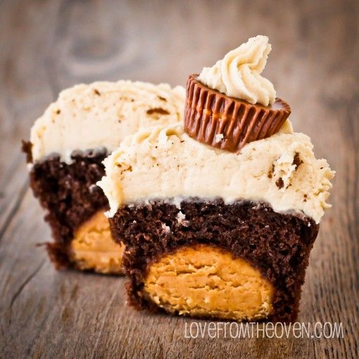 Peanut Butter Ball Chocolate Cupcakes with Peanut Butter Buttercream. Almost looks like Reese's eggs inside...those would also be awesome!