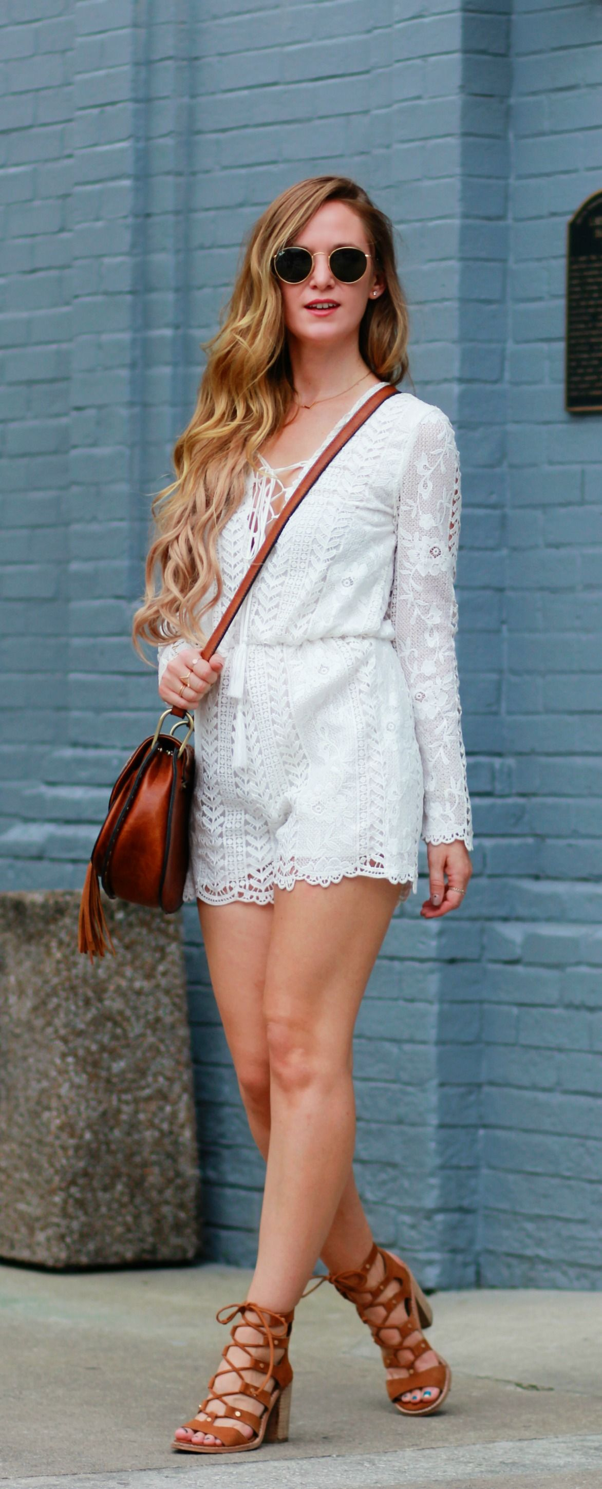 5214ea54510 Lace long sleeve romper styled with lace up block heels and tassel  crossbody bag