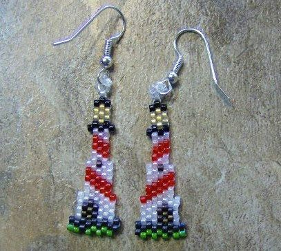 These cute light house earrings are done in the brick stitch with size 11 delica glass beads. The colors that I have used are black, crystal, lime green, white opal, lined gold, dark grey, purple iris, transparent red, and bronze iris. They measure 1 1/2 long. The designer is Barbara Elbe. Thank you for looing at my bead work. I do all of my own bead work one bead at a time. Have a blessed day.