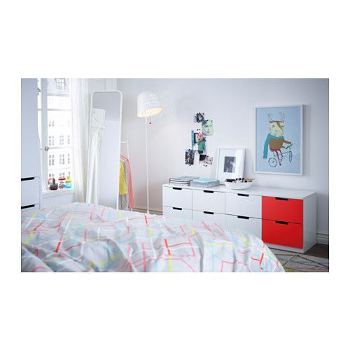 a white bedroom with white nordli modular chests with white and pink fronts and ikea ps quilt cover