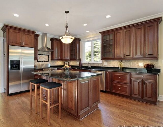 Traditional Tuesday Kitchen Of The Day Beautiful Cherry Cabinets Hardwood Floors Black Granite Countertops And An Island With Seating Give This