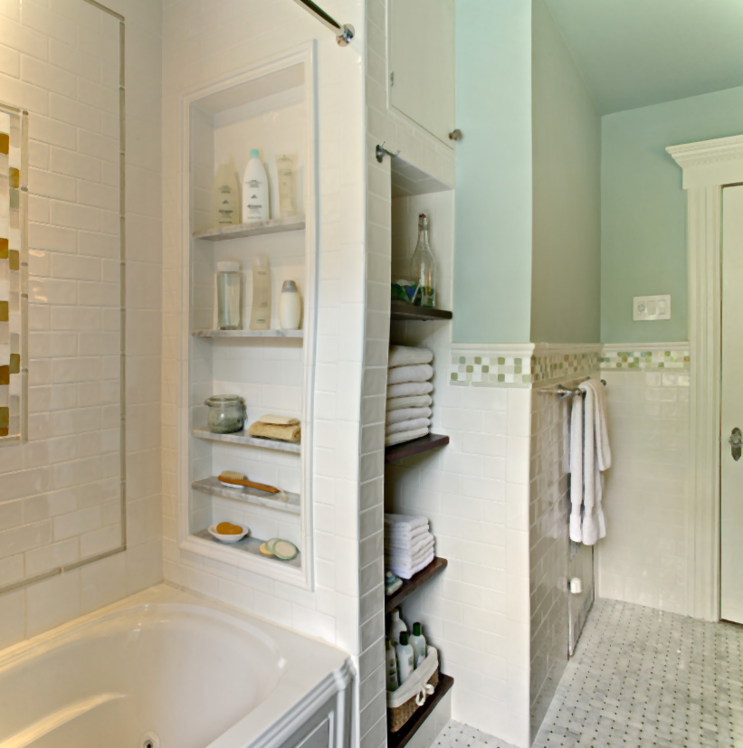 Simple Small Bathroom With Built In Storage Unit And White Bath Tub