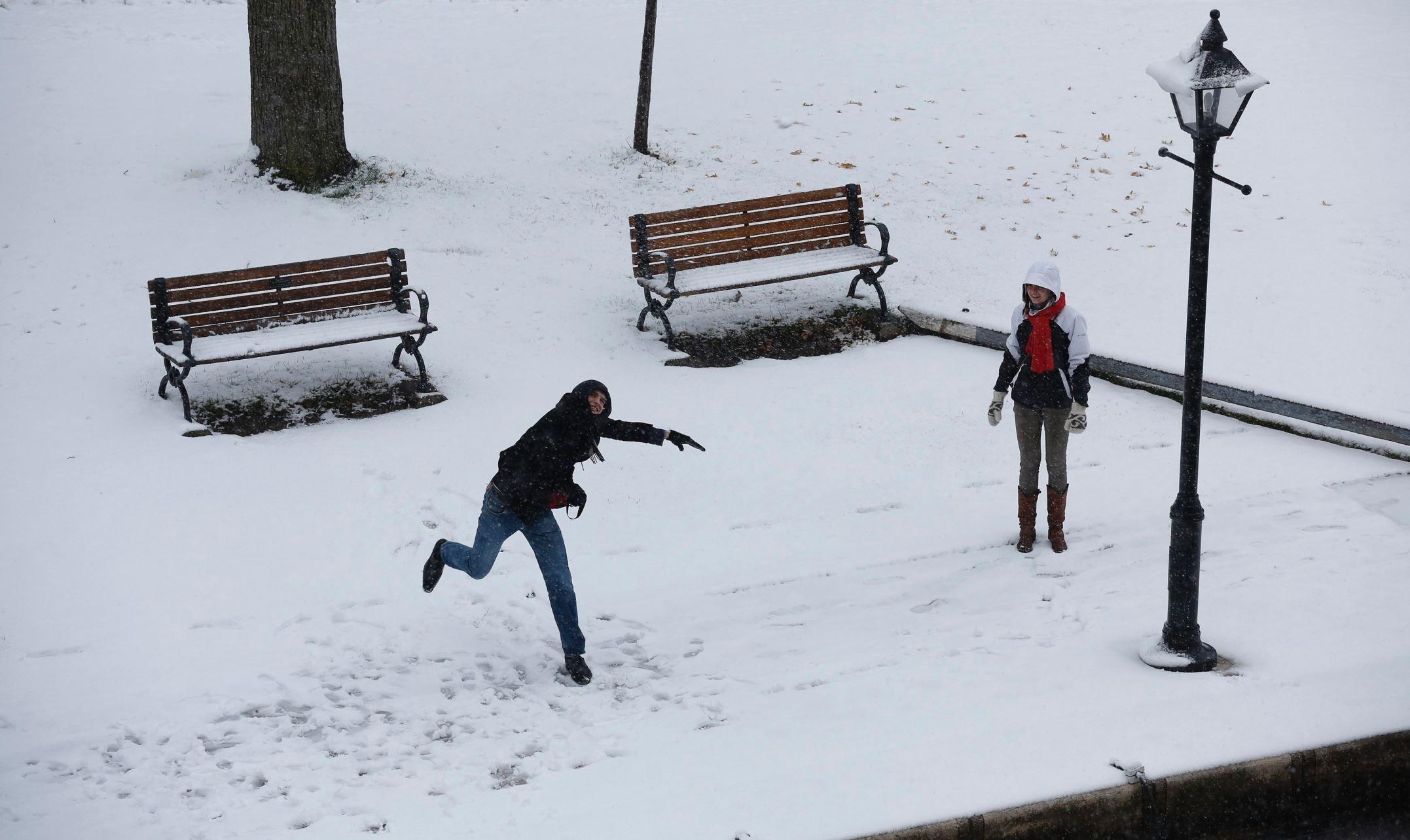 Ottawa, Canada; A man throws a snowball along the Rideau Canal.