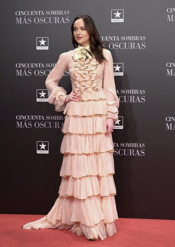For the premiere tour of 50 Shades Darker, Johnson has selected romantic looks with a twist. Here, a tumble of ruffles and tiered skirt make the whole look just a little twisted. Dakota Johnson in Gucci at the 50 Shades Darker premiere in Madrid, Spain, February 2017.  Fotonoticias/Getty Images