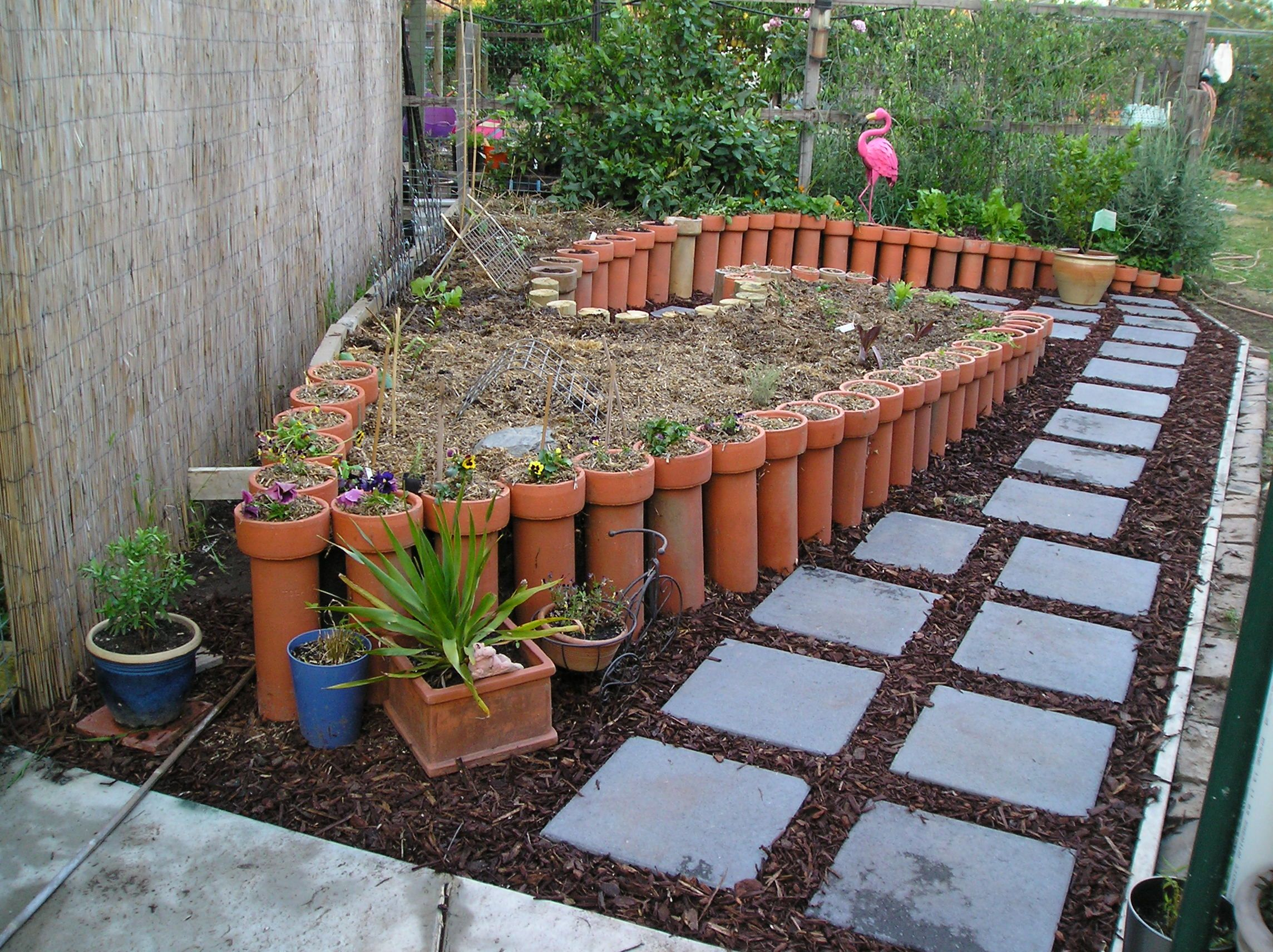 Herb Spiral Raised Garden, Retaining Walls Made With Terracotta Ag Pipes. I  Have Planted