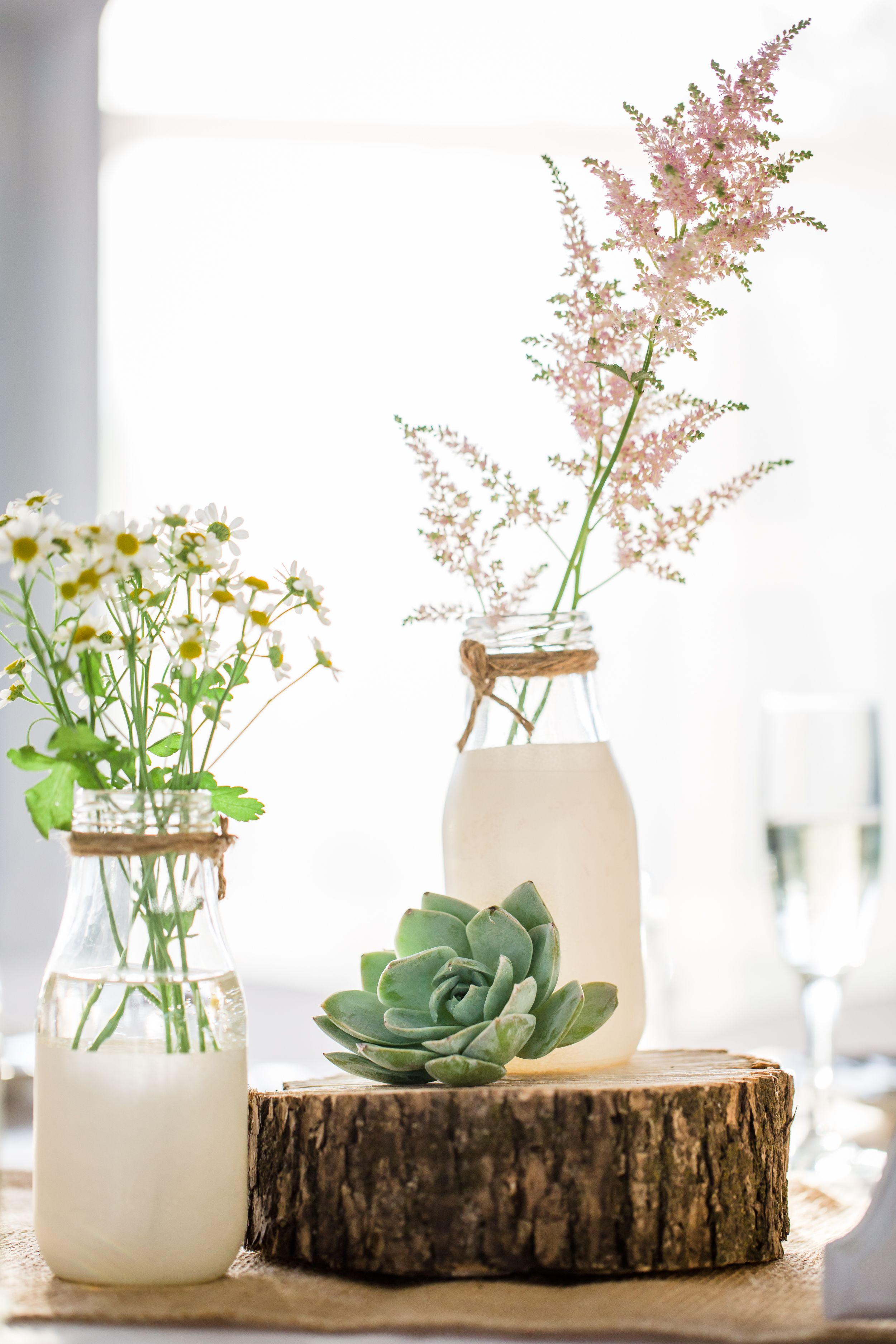 Diy milk bottle centerpieces with wildflowers wedding