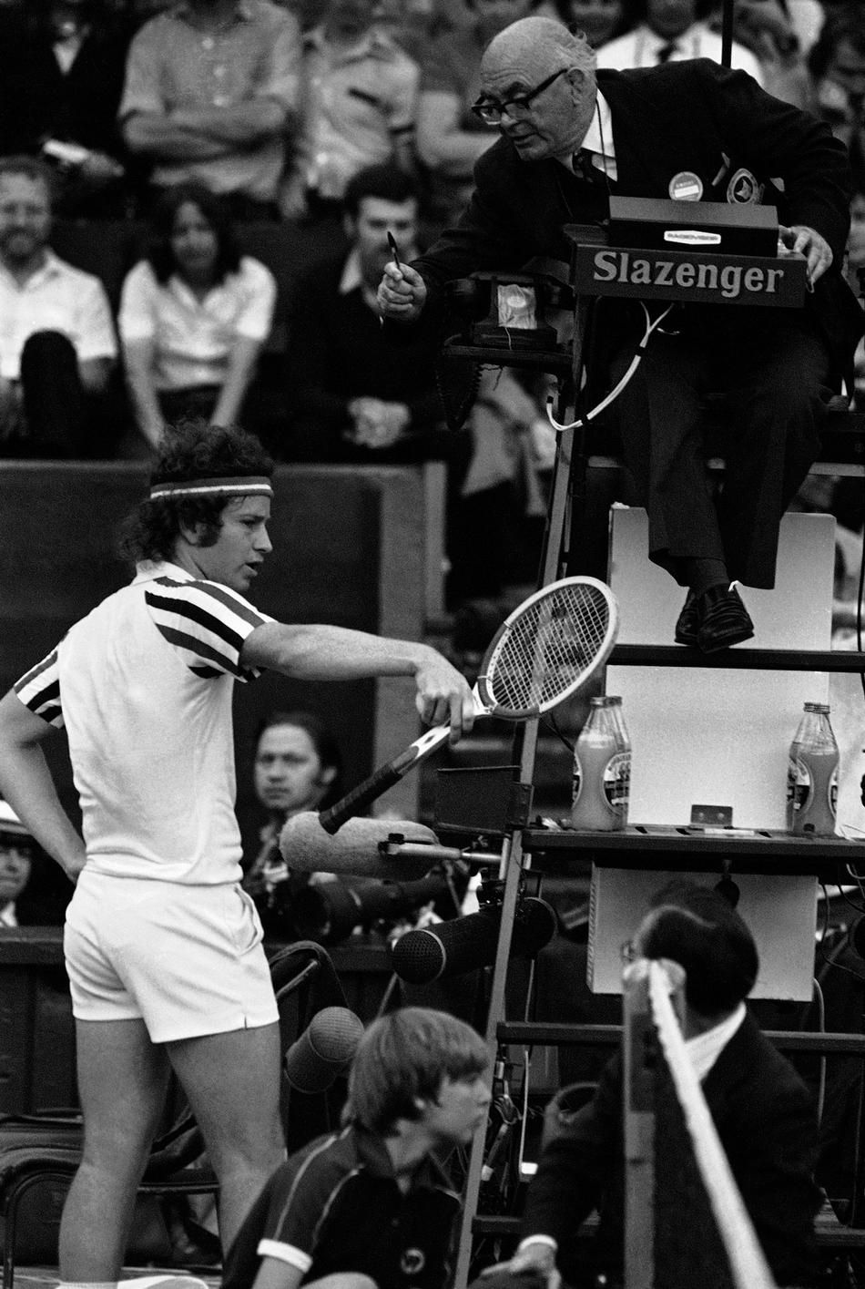 John McEnroe argues a line call with the umpire, during his Wimbledon Men's Singles Semifinal, Friday, July 4, 1980 against Jimmy Connors. McEnroe claimed that he aced Connors, but the umpire-who's decision was upheld - disagreed. (PA Photo)