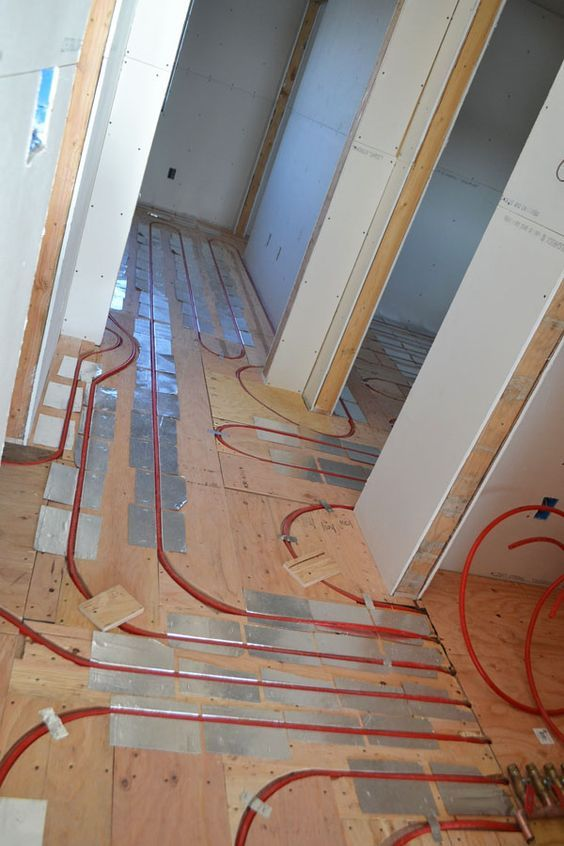 Underlayment and other parts of an in-floor heating system | House ...