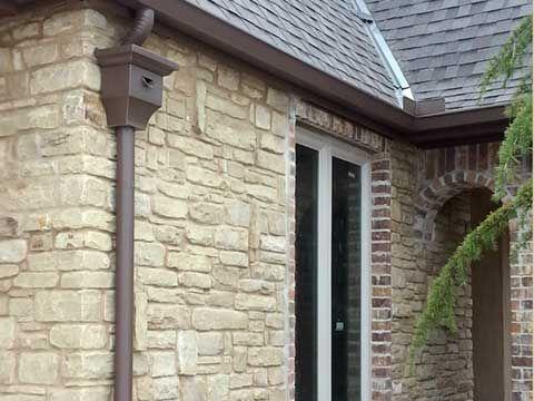 Dark Bronze Gutters Google Search Exterior Stone Shutters Exterior Gutters
