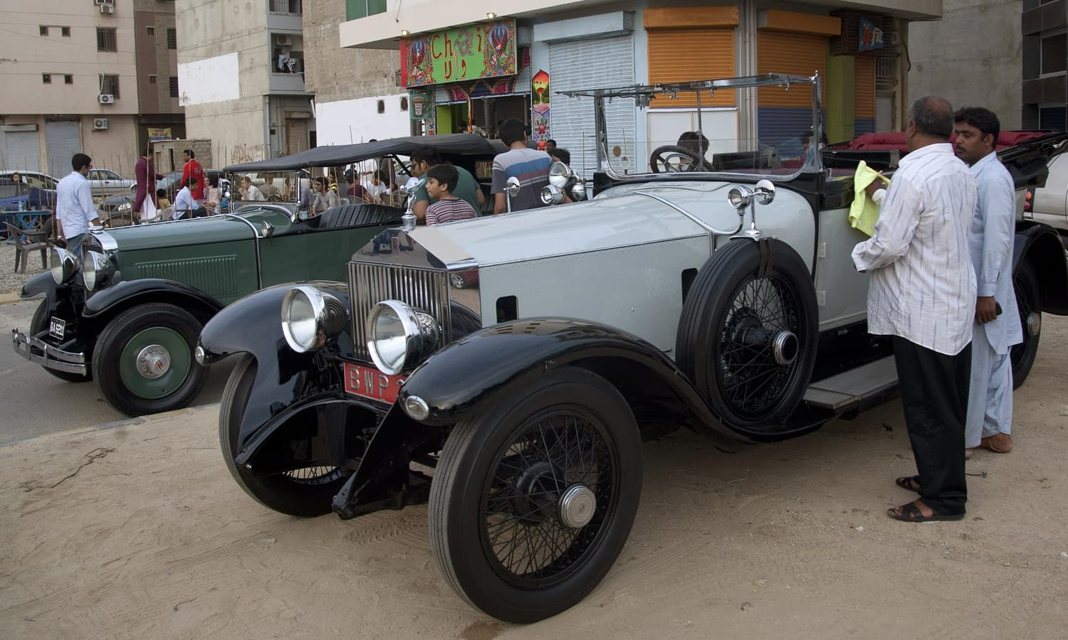 Classic cars parked outside a restaurant in Karachi. —AP Photo ...