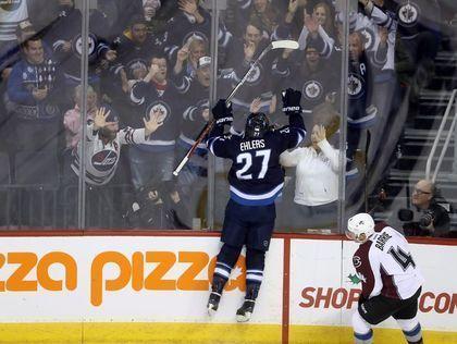 Winnipeg Jets' Nikolaj Ehlers (27) celebrates his third period goal as Colorado Avalanche's Tyson Barrie (4) looks…   Jets hockey, Winnipeg jets, Nhl hockey jerseys