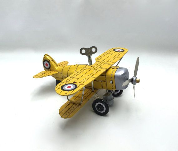 Vintage yellow tin wind-up toy airplane, collectible retro collection, available in yellow & dark green color