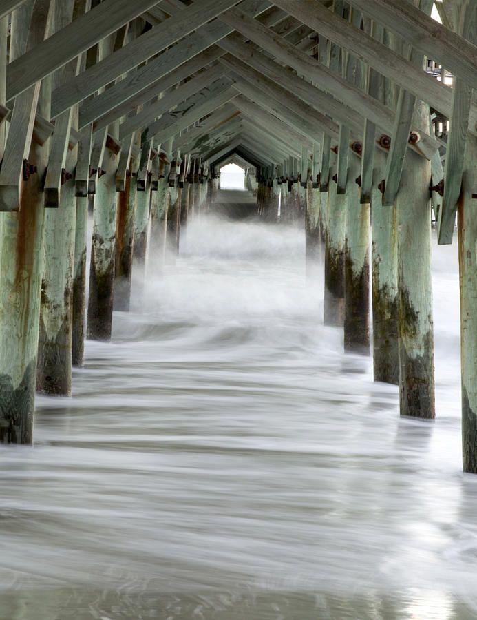 Fog rolling in under a pier