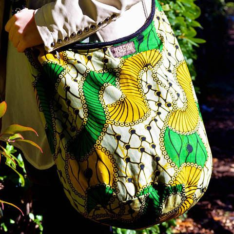 Made with unique Khanga prints, these bags are perfect for any occasion!  Features:    Zipper closure  Inner pocket  Hand-sewn by women in rural Kenya  Fashion changes quickly in the Nairobi markets; most of our prints are limited and one-time-only!