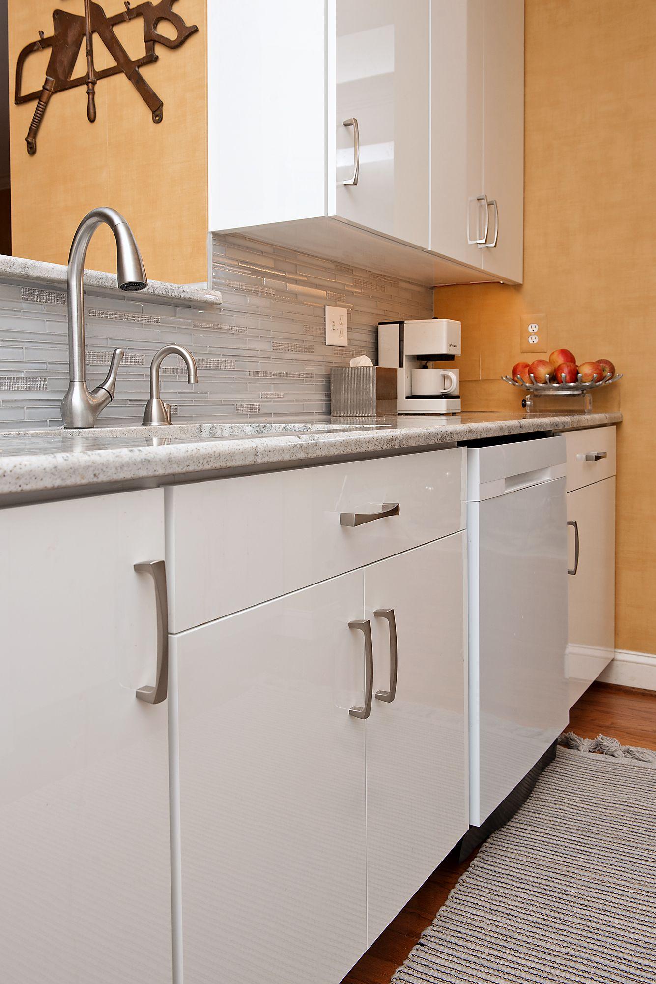 Striking Slab Doors Of High Gloss Laminate Set This Kitchen Apart