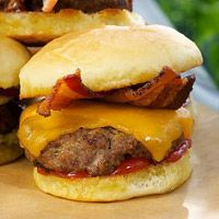 Bacon Cheddar Sliders    Here's the traditional indulgent American cheeseburger, slider-sized and topped with smoky bacon. Indulgent, yes, but it's just a mini burger with about 2 ounces of meat! Of course, you're going to want to eat more than one, but who's counting?