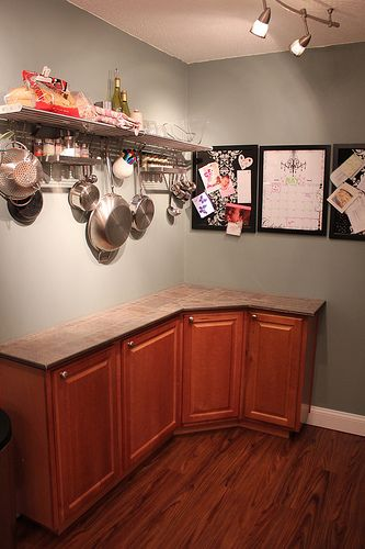 hanging pans and small countertop in condo kitchen makeover decor