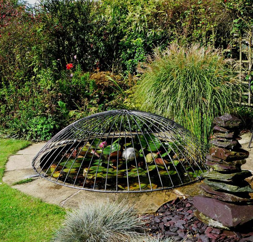 An image of a beautiful pond with a child safety pond for Garden pond safety covers