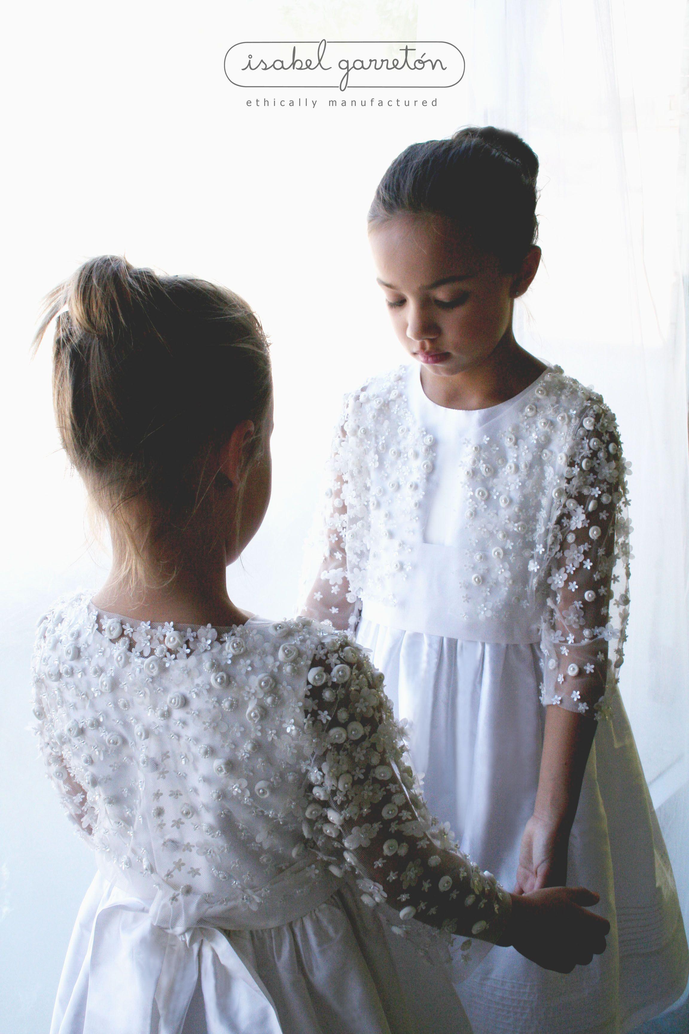 A Delicate Hand Embroidered Bolero Over A Timeless White Silk