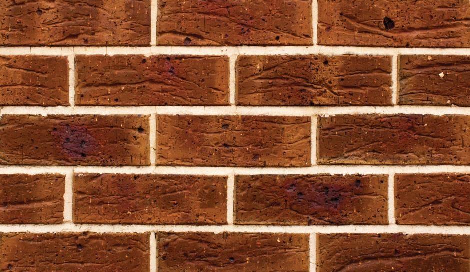 Exterior: Brick Pavers, Textured Walls