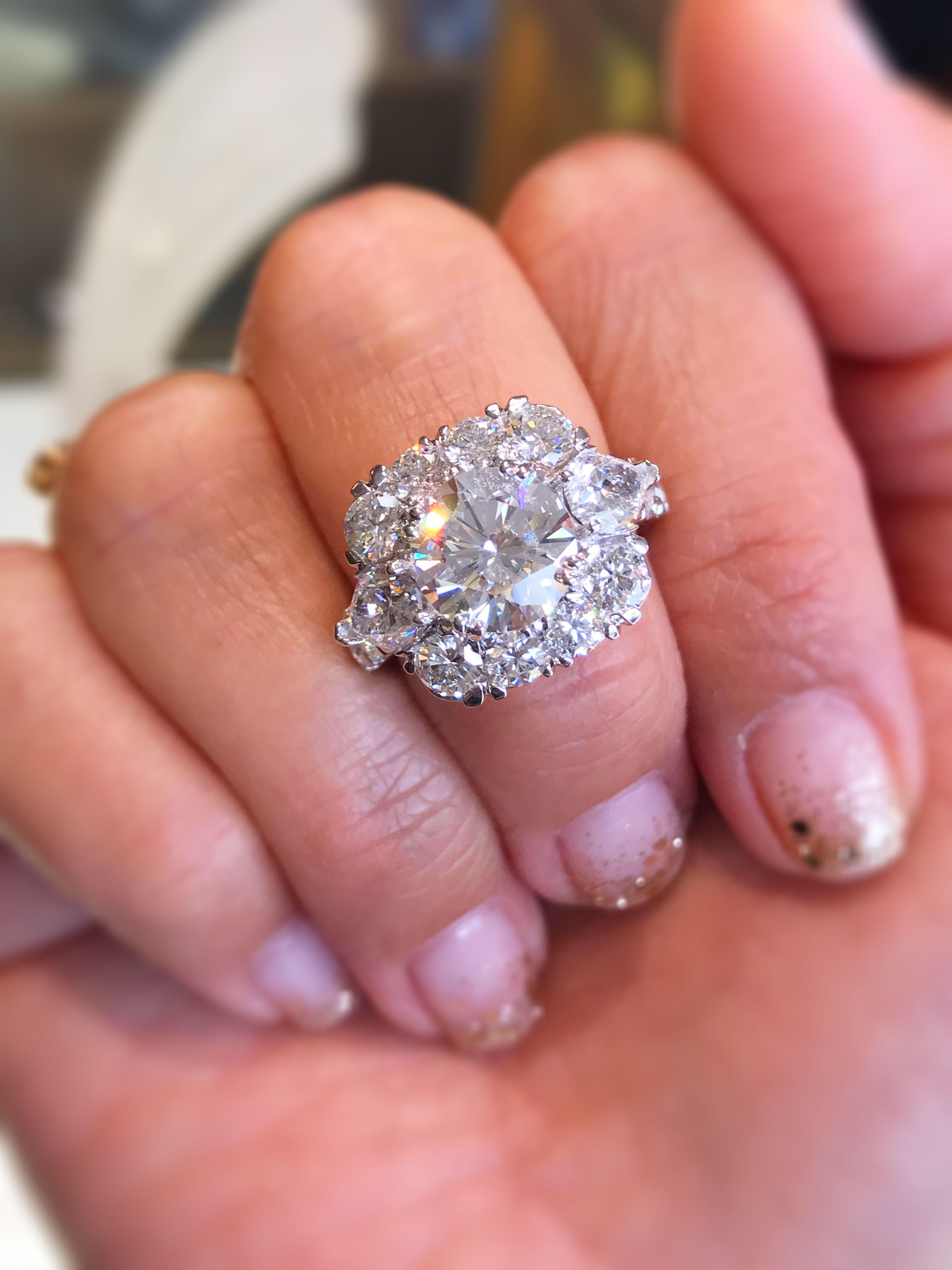 Custom engagement ring with impressive diamond halo and pear shape ...