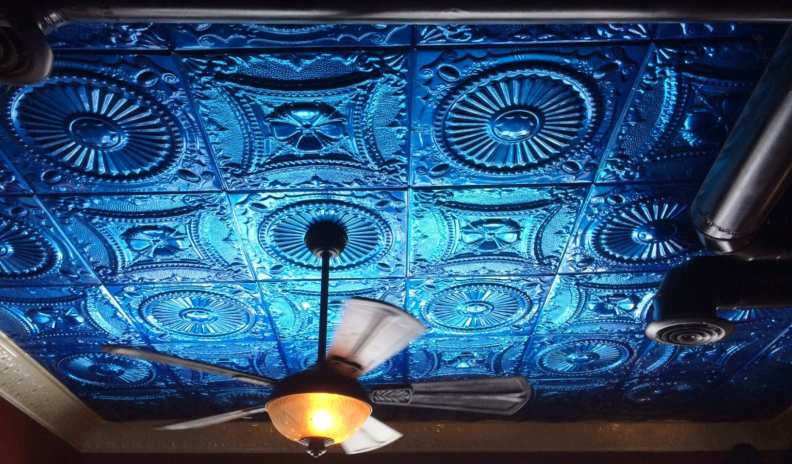 Melted bar and grilled in ohio uses a brilliant blue tin ceiling as commercial case studies with tin tiles american tin ceilings dailygadgetfo Images