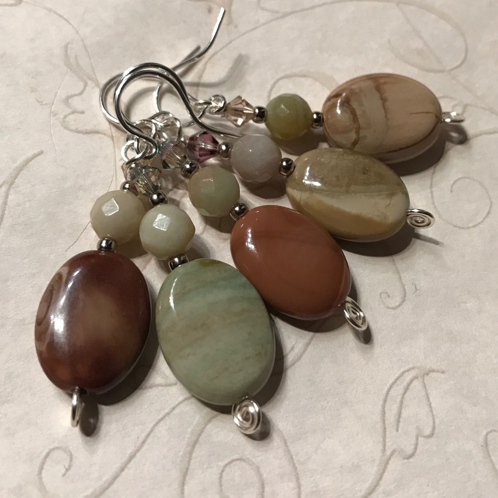 The Wilderness is Waiting #4 A set of five earrings: imperial jasper, amazonite, metal beads, silver wire, sterling silver earwires.   https://nemb.ly/p/H1xmlv4ag
