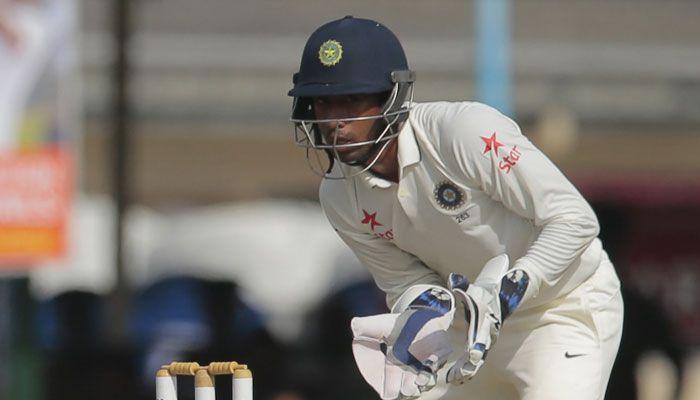 Saha took an excellent catch to dismiss Dane Villas off Ashwin's bowling.