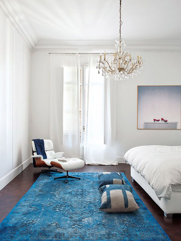 colorful classic Barcelona bedroom blue rug Eames lounge chair ...