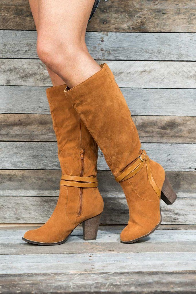 Rock a modern cowgirl look in our Fiona boots. With stylish, slouchy detailing and a sturdy stacked heel, these boots comfortably take you from city streets to a day at the ranch. They zip mid calf, f