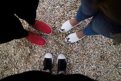 women feet shoes legs view from top jeans friendship