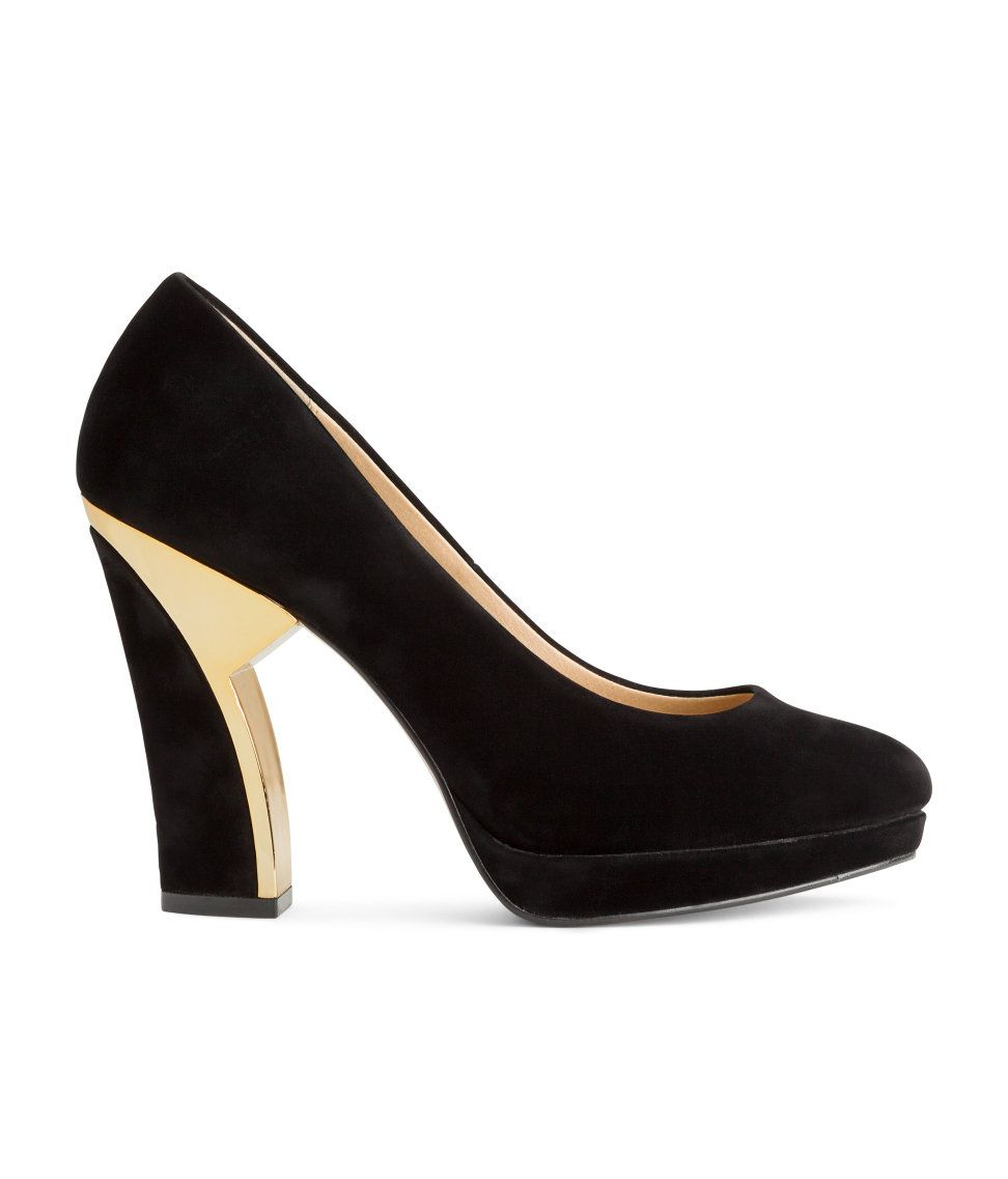 1c6fb530014 Black platform pumps with velvet finish and gold heel accent.