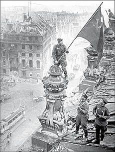 Jevgeni Chaldej, Raising the flag of the Reichstag, Berlin, 1945.