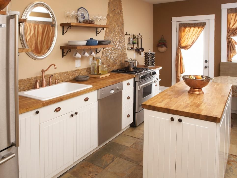 This beige kitchen is a warm space with butcher block ... on granite kitchen countertops ideas, kitchen countertop painting, kitchen countertop edges, kitchen countertops and backsplashes, kitchen countertop samples, kitchen counter backsplash design, kitchen countertop contact paper, tile countertop ideas, l-shaped kitchen layout ideas, kitchen countertop organizers, kitchen backsplash options, counter top ideas, kitchen countertop texture,